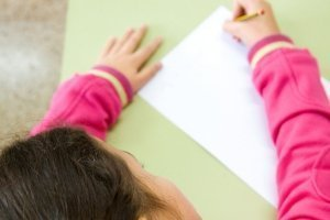 Helpful Homeschool Grading Tips, girl doing schoolwork