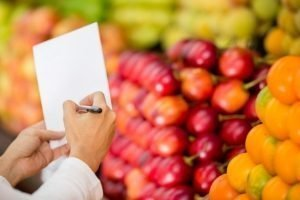 grocery shopping and checking off grocery list