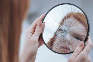 Reasons Not to Homeschool, woman looking into broken mirror
