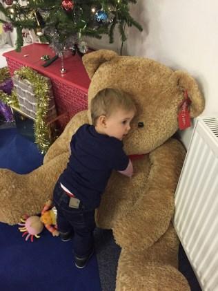 Cuddling teddy