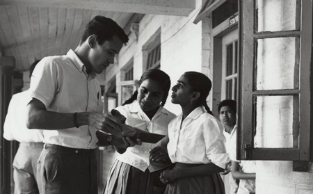 Peace Corps volunteer with students