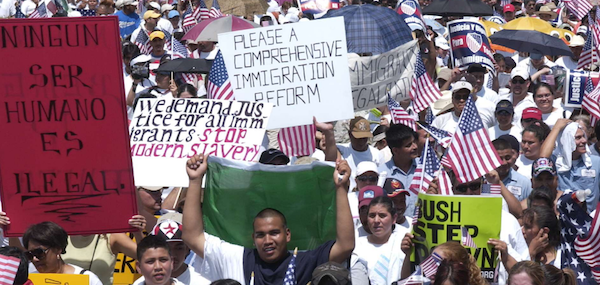 People at a march holding signs