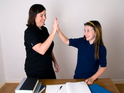 a job well done - mom giving daughter high five