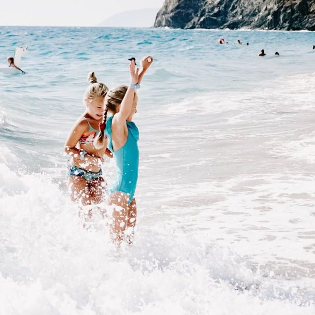 girls enjoying on beach