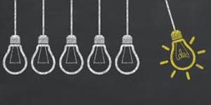 Idea light bulbs drawn on a chalk board