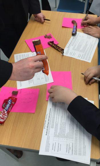 Students examining chocolate