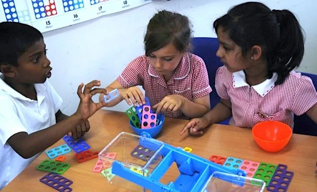 Children with Numicon pan balance