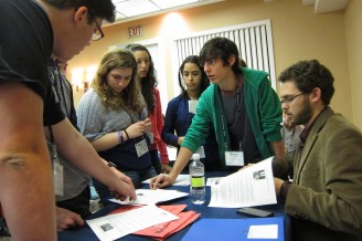 Students engage in debates, simulating legislation