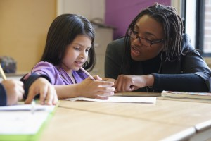 Teacher Helping Student - League of Education Voters