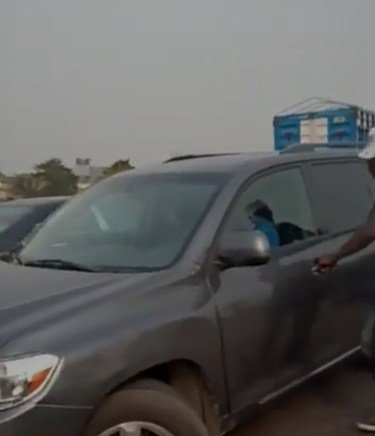 Mixed reactions as driver tips Lagos policeman over bridge (Video)