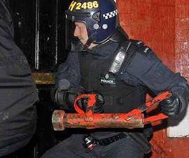 police breaking down door
