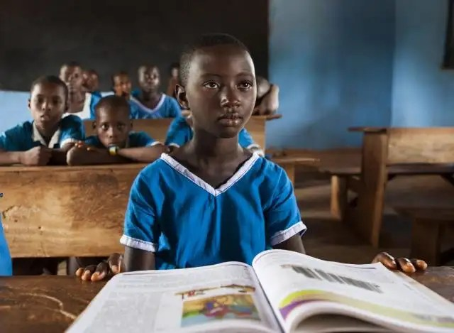 A textbook opened before a Nigerian pupil in a classroom of a local school