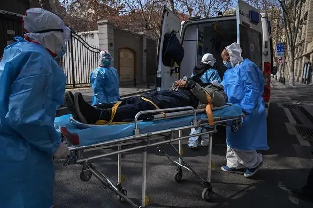 A coronavirus patient being moved to a hospital