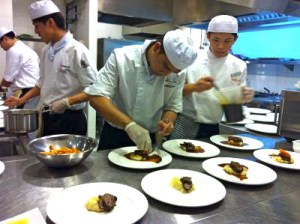 HELP CAT Culinary students plating the braised beef cheek, horseradish mash and carrots.