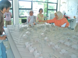 UCSI University Architecture students showing their model of the Sungai Buloh Leprosy Centre to the residents and its caretakers.