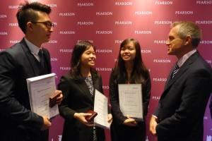 Mr Steven McGill, Head of Pearson's Asia Partner Markets, chats with 3 of the 5 High Achiever Award winners from HELP Academy and congratulates Melissa Chee (center) on having gained admission to Cambridge.