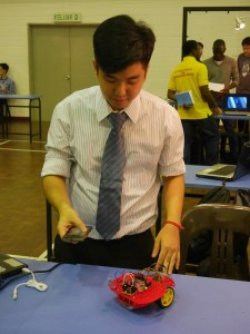 KBU International College Final year 3+0 Sheffield Hallam University's electrical & electronic engineering student, Ng Wern Jun, controlling the PSoc-Based Robot with the Android App in his mobile phone using Bluetooth.