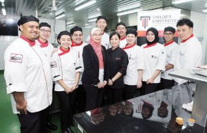 Deputy Dean, Siti Ramadhaniatun Ismail (5th from left) and Dr Chong Li Choo (6th from left) with the students of the School of Culinary Arts at Taylor's University Lakeside Campus in Subang Jaya