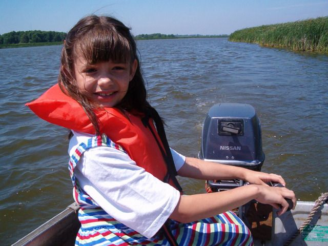 Driving the boat, Wolfe Island, 5 yrs