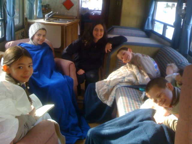 This is the day we left our house for good… in our camper, 2008. Look how little the kids are! (We may have been insane!)