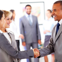 Image Of Smiling Business People Shaking Hands.