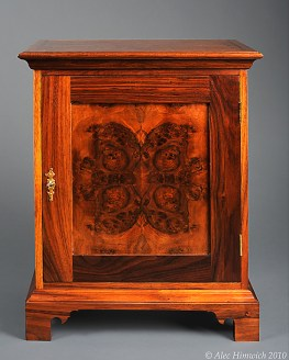 This spice chest is of a representative style of spice chests common among the Quakers of Chester County. These chests were popular in the 18th century as a means of secure storage for valuable spices. The primary wood is black walnut. The drawer fronts are 4 way bookmatched quilted claro walnut. The door front is bookmatched walnut burl. The secondary wood is poplar. Joinery is both through and half blind dovetails. The metal fittings are a mortied keyed lock and brass drawer pulls.