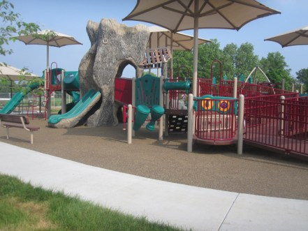 Ground image of the tree trunk structure and slides on the new boundless playground.