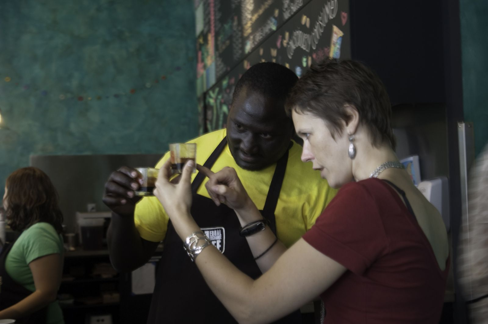 Amen Mtui, a cupper from KNCU in Tanzania, and Beth Ann Caspersen, Equal Exchange Quality Control Manager, at the Equal Exchange Cafe in Boston, Mass.
