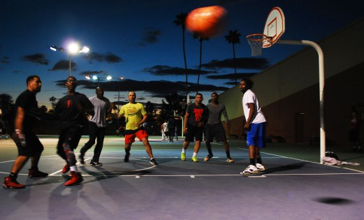 A group of eight men play a pick-up basketball game at Encanto Park in Phoenix, Arizona on February 26, 2017.