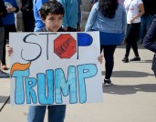 Paul Fierro holds an anti-Donald Trump sign during a protest organized by Living United for Change in Arizona in the courtyard at the Arizona State Capitol in Phoenix on February 20, 2017.