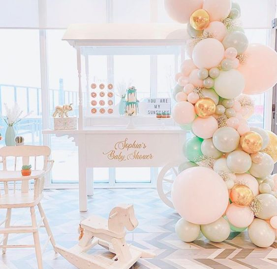 candy cart with golden elements and balloons