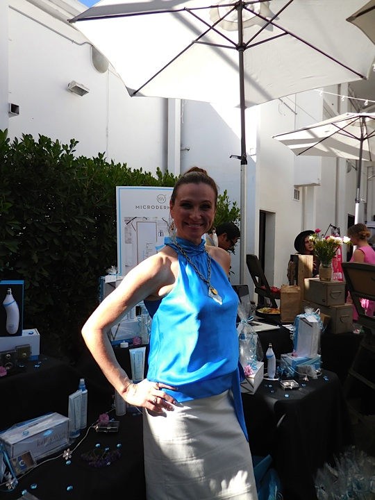 Cindy from Microderm 360 is all smiles for the gifting suite attendees