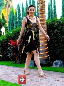 Golden entrance...I strutted to the fashion show in one of Sue's alluring gowns. Makeup by Blushington, jewelry courtesy of the Mitra Collection and my shoes are vintage. Photo courtesy of Winston Burris/Burris Agency and Contact Music