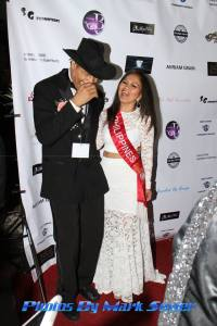 Reporter and award recipient Cerdan Smith shares a laugh on the red carpet with beauty queen Mrs. Indonesia Amelia Johnson. Photo courtesy of Mark Sevier