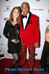 Celebrity photographer and award recipient Sheri Determan is all smiles on the red carpet with Eugene. Photo courtesy of
