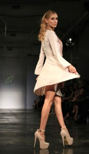 Model twirls in a dress from the ready-to-wear line. All photos courtesy of Burris Agency Staff