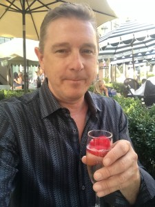 Writer and photographer for the Experience Magazine, Dustin Brown, enjoying a glass of the Kir Royal at Ladurée