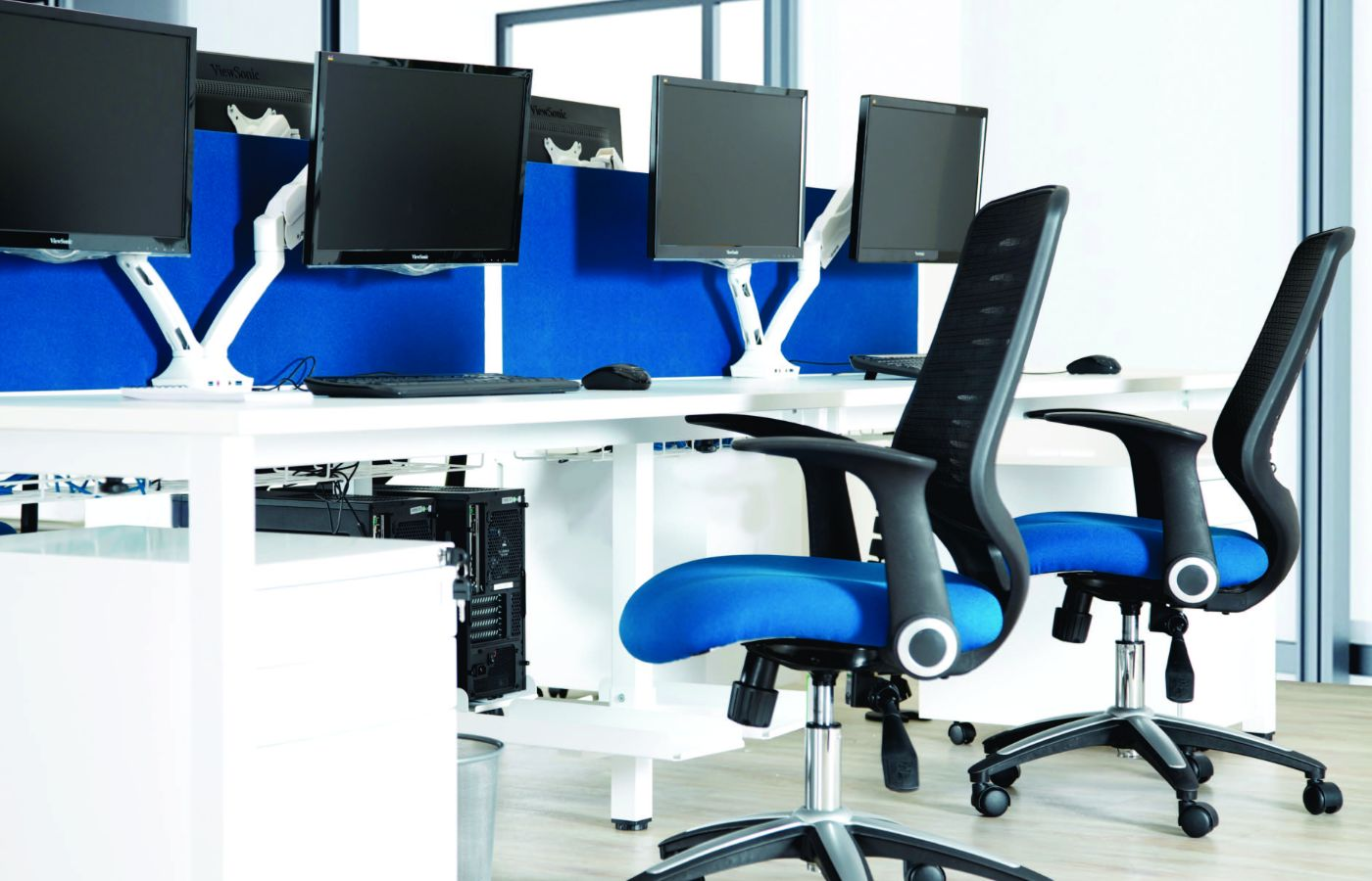 blue office chairs with floating monitors
