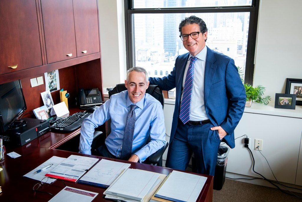 Jay Freiberg and Howard Elman with slight smiles in business suits - NYC Trust and Estate Litigation