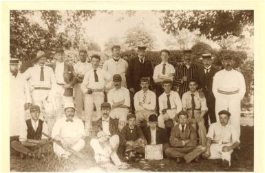 Theydon Bois cricket club wearing whites and caps