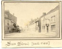Row of buildings including the New Inn Public House in Sun Street