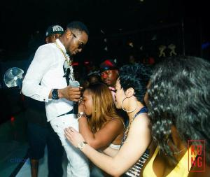 What is this Lady looking for inside D'Banj's Trouser