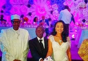 President-elect Buhari with Governor Adams Oshiomhole and Wife as they cut Wedding Cake (Photos)