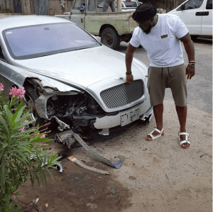 Timaya escapes unhurt from accident, involving his Bentley (Photos)