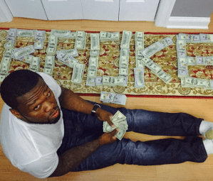 50 Cent shows off wads of Dollars (Photos)