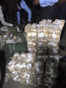 Escaping armed robbers in Port Harcourt abandon their operational car containing N137m (Photos)