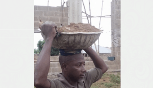 Lecturer shares photo working as a labourer in Kwara, due to non-payment of salary for 6 months