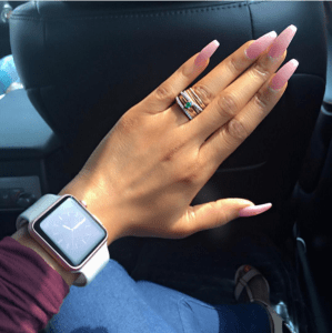 Toke Makinwa gushes about her nails… or maybe her wedding ring (Photos)
