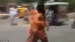 Man engulfed in ball of flames after his phone catches fire in his pocket (Photo + Video)