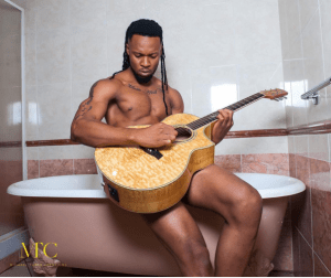 Flavour shares half naked photo playing guitar